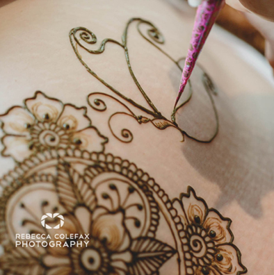 Henna art on pregnant belly